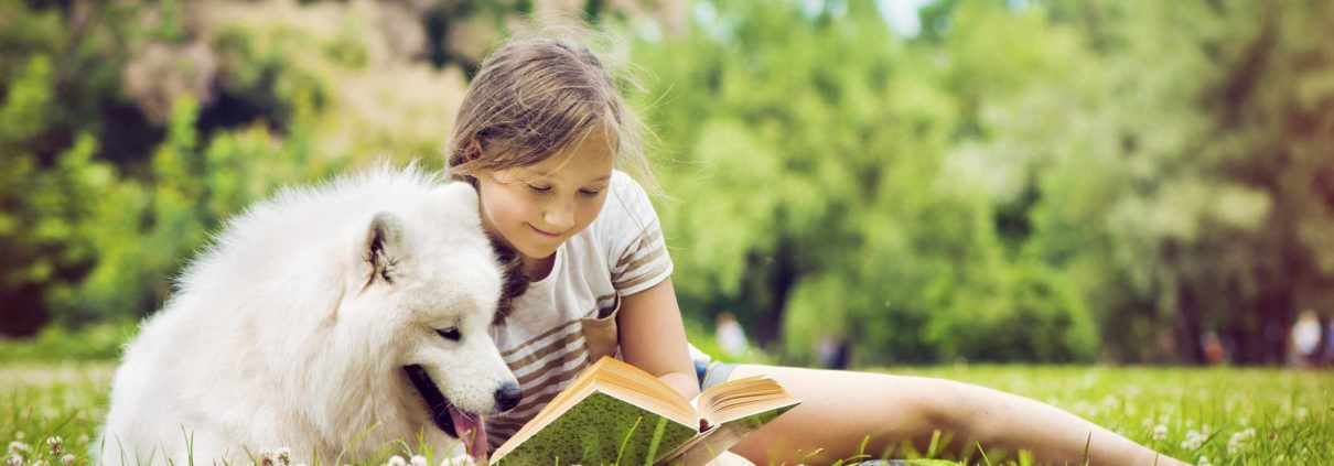 kid-dog-reading-outside-summer-ArtMarie-56b750f43df78c0b135f9269